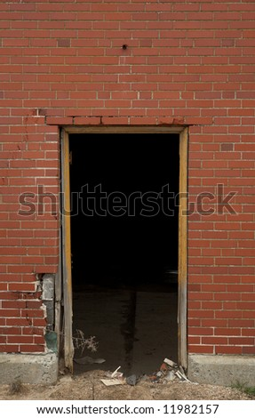 High resolution open doorway on brick wall background - stock photo