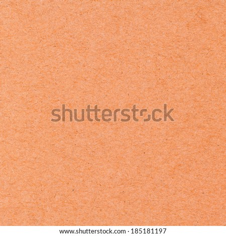 High resolution orange recycled paper texture as background - stock photo