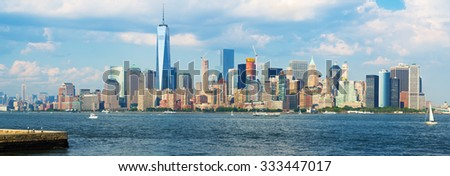 High resolution panoramic view of the downtown Manhattan skyline from the New York Harbor - stock photo