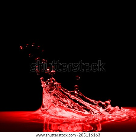 High resolution, splash of red wine on black background - stock photo