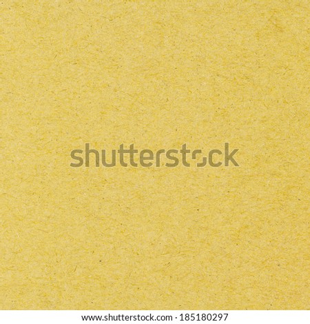 High resolution yellow recycled paper texture as background - stock photo