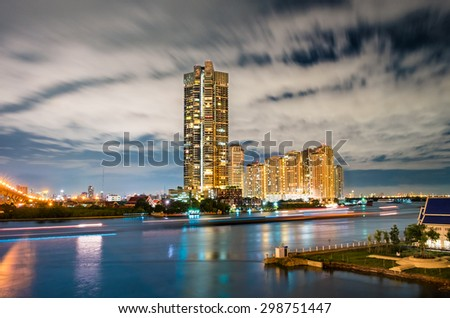 High-rise apartment buildings by the Chao Praya river in Bangkok, Thailand. - stock photo