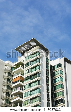 high rise apartments with clear blue sky - stock photo