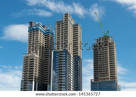 High-rise building under construction - stock photo