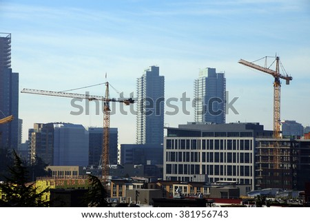 high rise construction cranes  across downtown  Seattle, Washington - stock photo