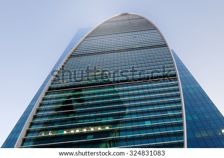 High-rise office building against the blue sky. Bottom view - stock photo