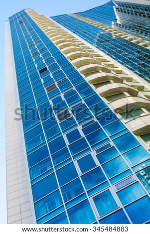 High-rise residential building on a background of blue sky. Photo from a lower angle.  - stock photo