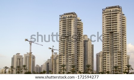High-rise residential buildings under construction. The site with cranes   - stock photo