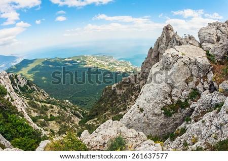 High rocks Ai-Petri of Crimean mountains. Black sea coast and blue sky with clouds. Russia. Photographed fisheye lens - stock photo