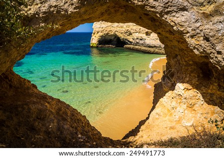 High rocky coastline with beaches in the Algarve, Portugal - stock photo