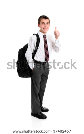 High school boy standing in uniform showing a thumbs up hand sign, eg success, approval, great, etc... - stock photo