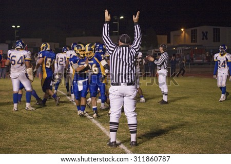 High school football referee calls touchdown as Ojai Nordhoff Rangers Football team defeats Verbum Dei Eagles 21-0 on November 19, 2010, Ojai, CA, USA - stock photo