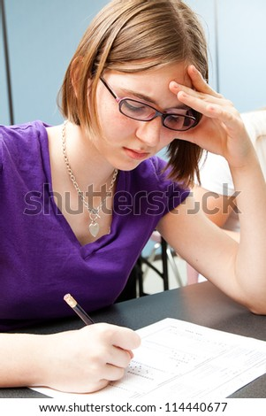 High School girl taking an standardized achievement test in school. - stock photo