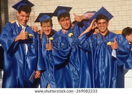 High school graduates celebrating, Providence, RI - stock photo