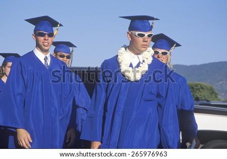 High school graduates wearing sunglasses and a lei, Nordhoff High School, Ojai, CA - stock photo