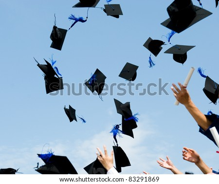 high school graduation hats high - stock photo