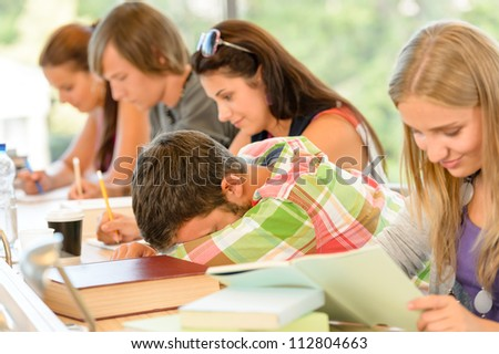 High-school student falling asleep in class teens lesson college bored - stock photo