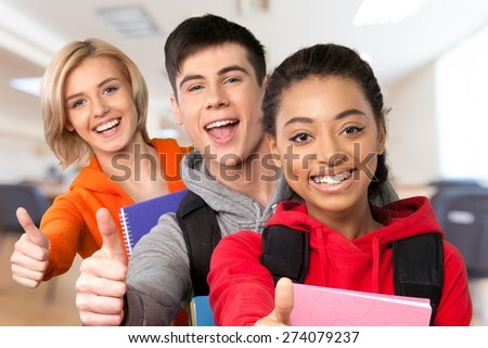 High School Student. Group of smiling teens showing ok. - stock photo