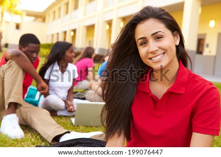 High School Students Studying Outdoors On Campus - stock photo