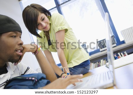 High School Students Using a Laptop - stock photo