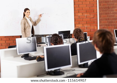 high school teacher teaching in classroom - stock photo