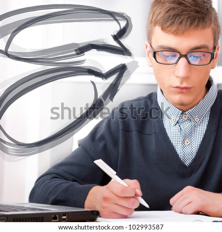 High school - Young male student write notes in classroom. Design blank balloons with his thoughts around his head - stock photo