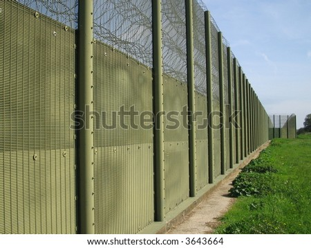 High security fence - stock photo