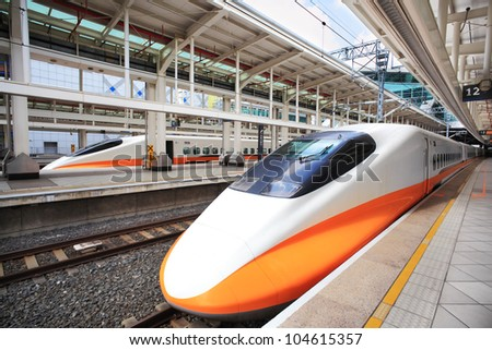 High speed bullet train by the railway station - stock photo