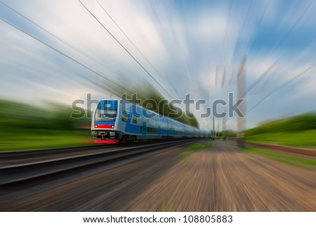 High-speed commuter train with motion blur - stock photo