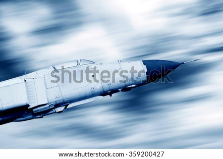 High-speed flight fighter, blue tone image. - stock photo