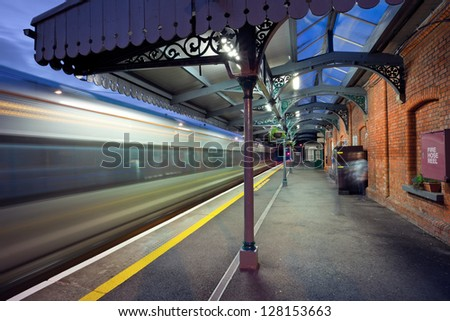 High-speed  intercity train in motion and  Athenry station at night, Ireland - stock photo