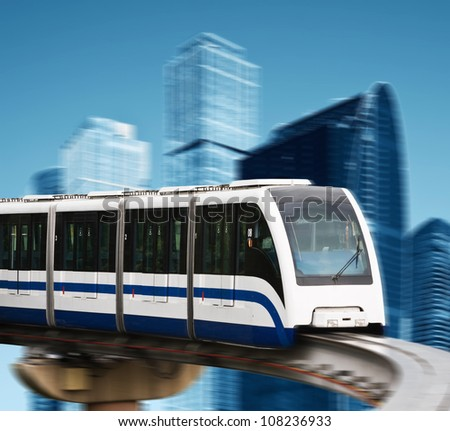 high speed monorail on a background of skyscrapers - stock photo
