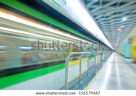 High speed subway train in motion blur - stock photo