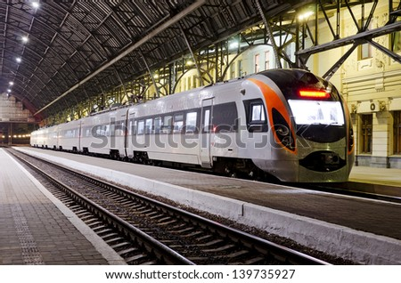 High-speed train at the night on the railway station in Lvov, Ukraine - stock photo
