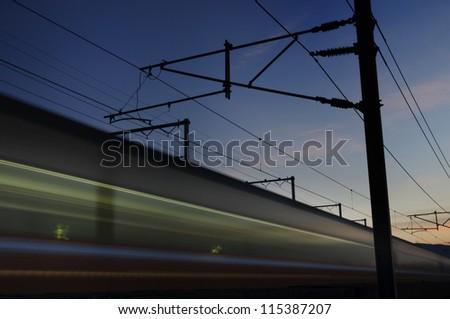 High speed train in sunset - stock photo
