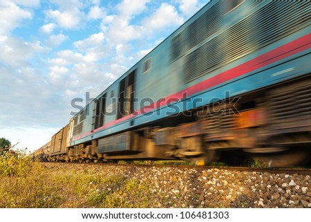 High-speed train that runs through the countryside. - stock photo