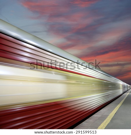 High-speed train with motion blur outdoor (against the sky)  - stock photo