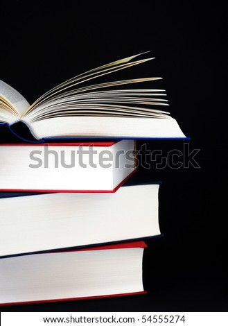 high stack of books on black background - stock photo