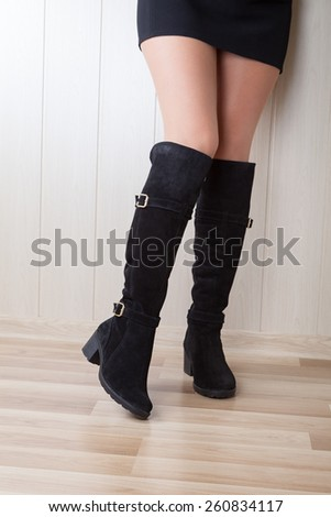 high suede boots with beautiful legs - stock photo