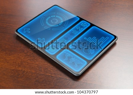 High-tech tablet on table - stock photo