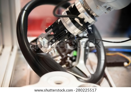 High technology robotic arm closeup photo in factory - stock photo
