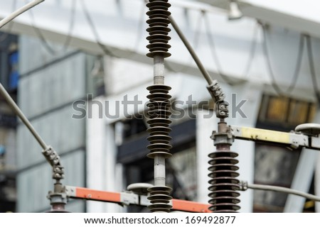 high tension electric wire porcelain spacer (high voltage) - stock photo