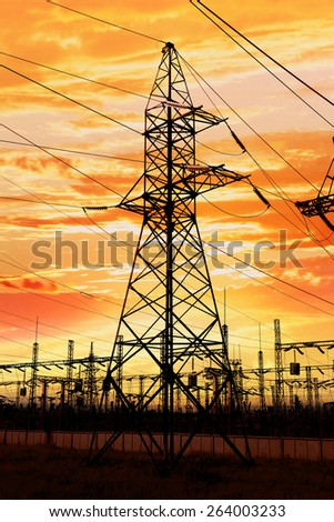 High-tension power line on sunset - stock photo
