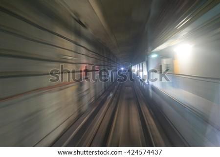 High velocity speeding underground train long exposure - stock photo