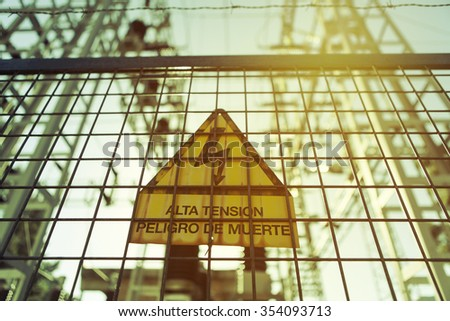 High voltage. Danger of death. Sign with text in spanish. - stock photo