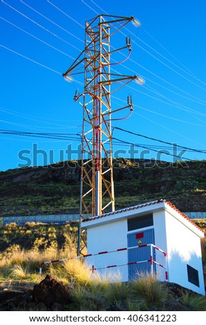 High-voltage electric pylon and electricity substation - stock photo