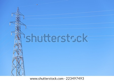 High voltage electrical power line. Color image - stock photo