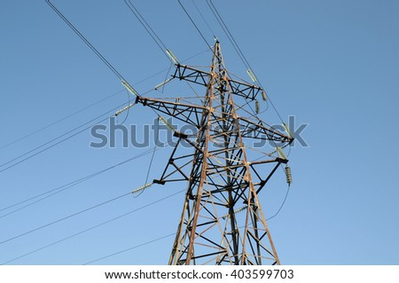 High-voltage electrical tower against the sky with many power lines - stock photo