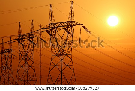 high voltage electrical tower during sunset - stock photo