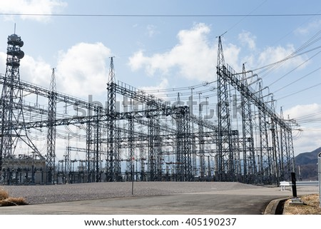 High voltage electrical towers - stock photo